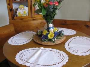 Linen Easter Lily oval place mat an elegant setting for cordial family gathering.