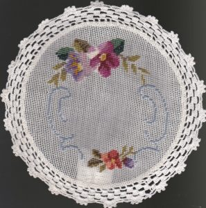 Woolen Needlepoint Petit Point 8 inch tea coaster with elaborate crochet trim.
