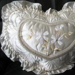 Satin Embroidered Floral Heart Pillow in Natural shade for a tranquil home.