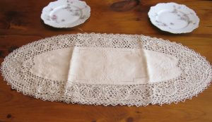 Pure Linen Reticella Lace place mat doily in Ecru colour with hand embroidered decoration.