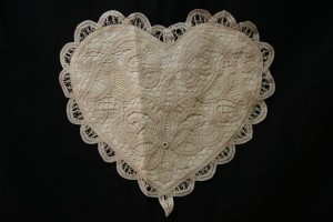 Solid Battenburg Lace Cushion cover is beautifully crafted accordingly to a perfect heart shape, complete with lace trimmed edge and lace ring. Available in White or Ecru colours.