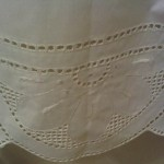Starburst shower curtain features punch work embroidery. Centre part with tie-backs. Percale Cotton/Polyester blend.