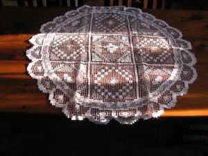 Hand knotted Tuscany Lace Round shape table topper.