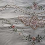 Peaches and Cream luncheon tablecloth with Punchwork and embroidery; Easy care cotton/polyester blend.