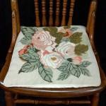 Adam first tea rose woolen needlepoint tapestry as a chair pad.