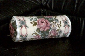 Roses and Ribbons woolen needlepoint neck roll.