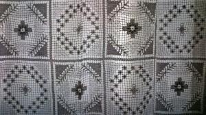 Handmade Modano Tuscany Lace tablecloths as no-sew curtain panel.