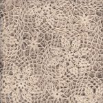Crochet lace bed cover in a creative interpretation of Star+Flower+WagonWheel patterns.