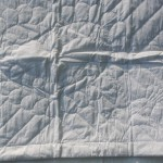 Heirloom quality Wedding quilt with Italian Trapunto Wedding Doves and Irish Claddagh Ring accents.