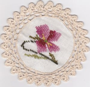 Woolen Needlepoint Gros Point 6 inch tea coaster with crochet trim picoted rosebuds.