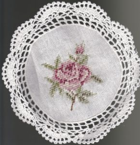 Woolen Needlepoint Gros Point 8 inch tea coaster with crochet trim.